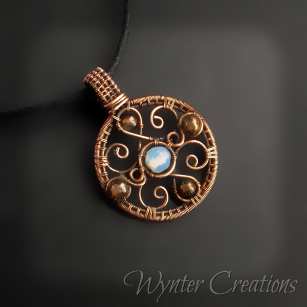 Copper filigree pendant with opalite glss