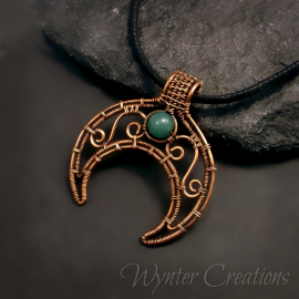 Pagan moon symbol with green aventurine