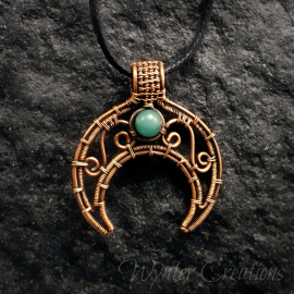 Copper filigree moon pendant