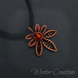copper cannabis leaf pendant with carnelian