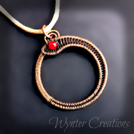 Circle snake pendant in copper