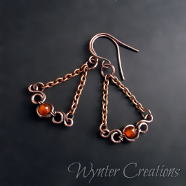 wirework earrings with orange gemstone