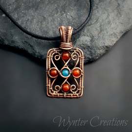 Orange and blue wire wrap pendant